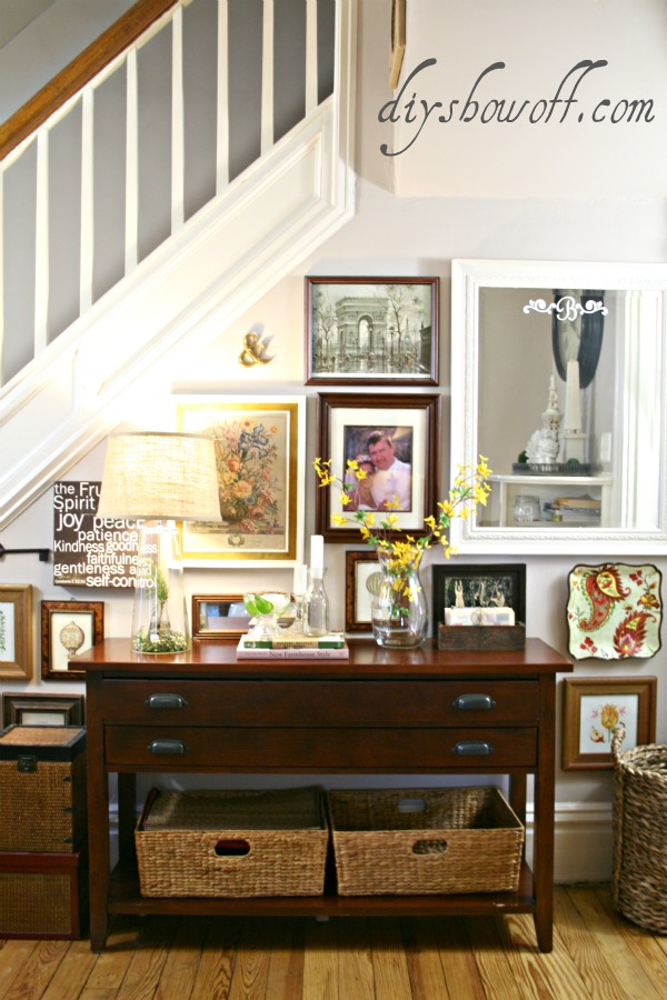 gallery wall, thrift store wall art, console table, stair wall, living room