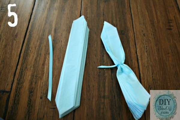 tie and knot ribbon around tissue paper