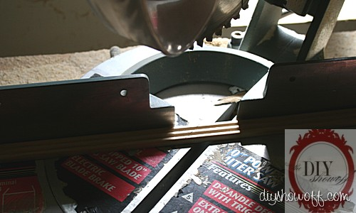 cutting wood trim with a miter saw for a diy wood sign