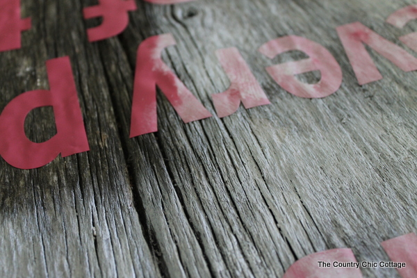 painting reclaimed wood sign