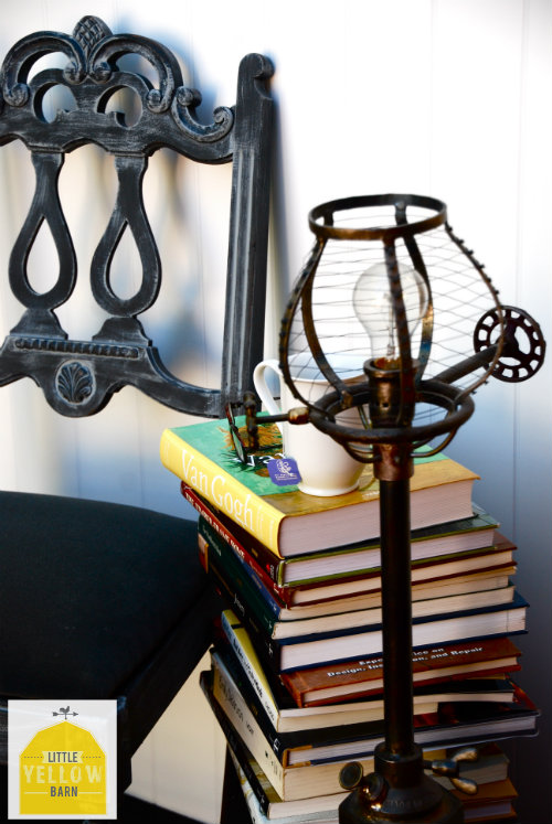 chair, books, vintage lamp