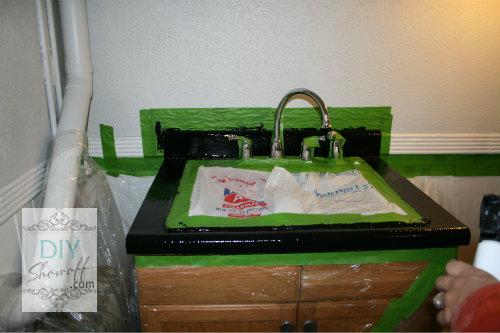 adhesive base coat around sink