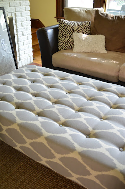Repurposing the old coffee table was a genius idea! And what a beautiful  home surrounding it! tufted upholstered ottoman