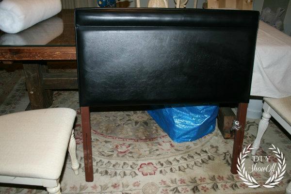upholstered headboard before