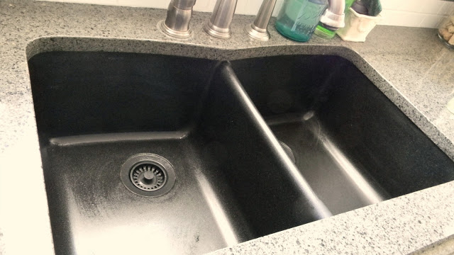 cleaning a granite sink at Forever Decorating