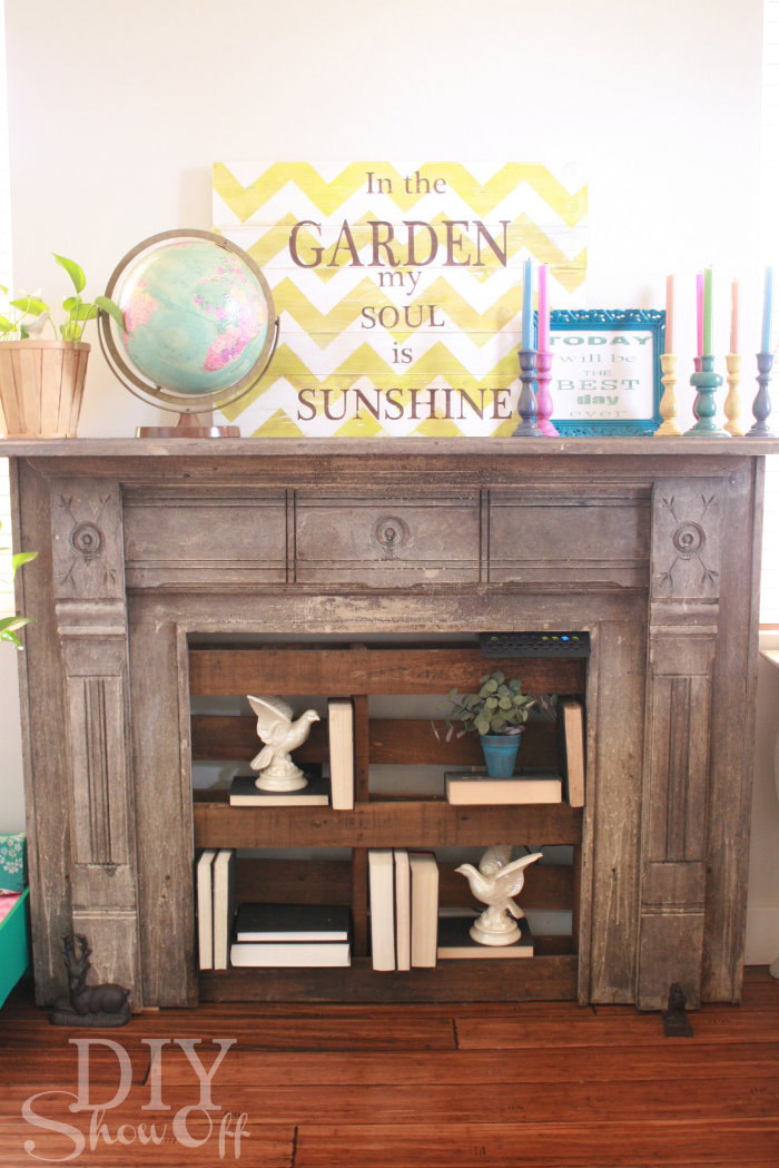 faux fireplace with pallet shelving