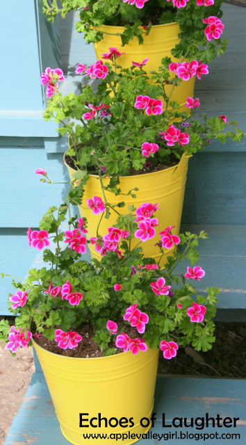 http://www.echoesoflaughter.ca/2012/05/spray-painted-bucket-planters.html