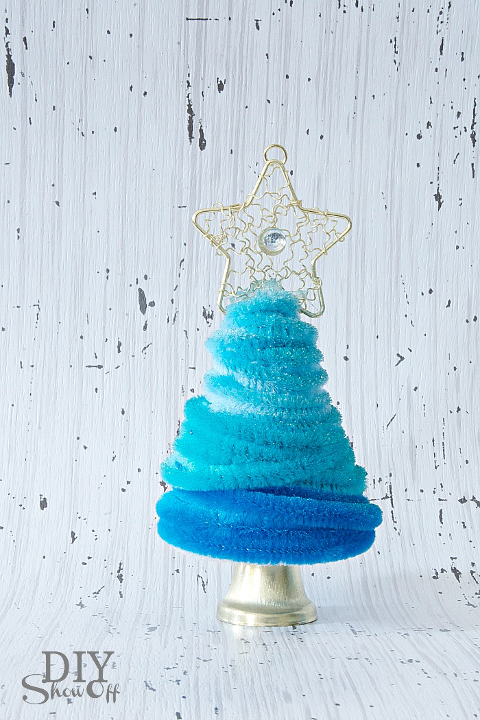 add a smidge of hot glue to the top of a bell and insert into the bottom center of the styrofoam cone to create a bell tree trunk pipecleaner christmas - Pipe Cleaner Christmas Tree