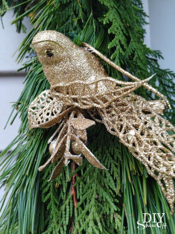 fresh pine garland and gold bird