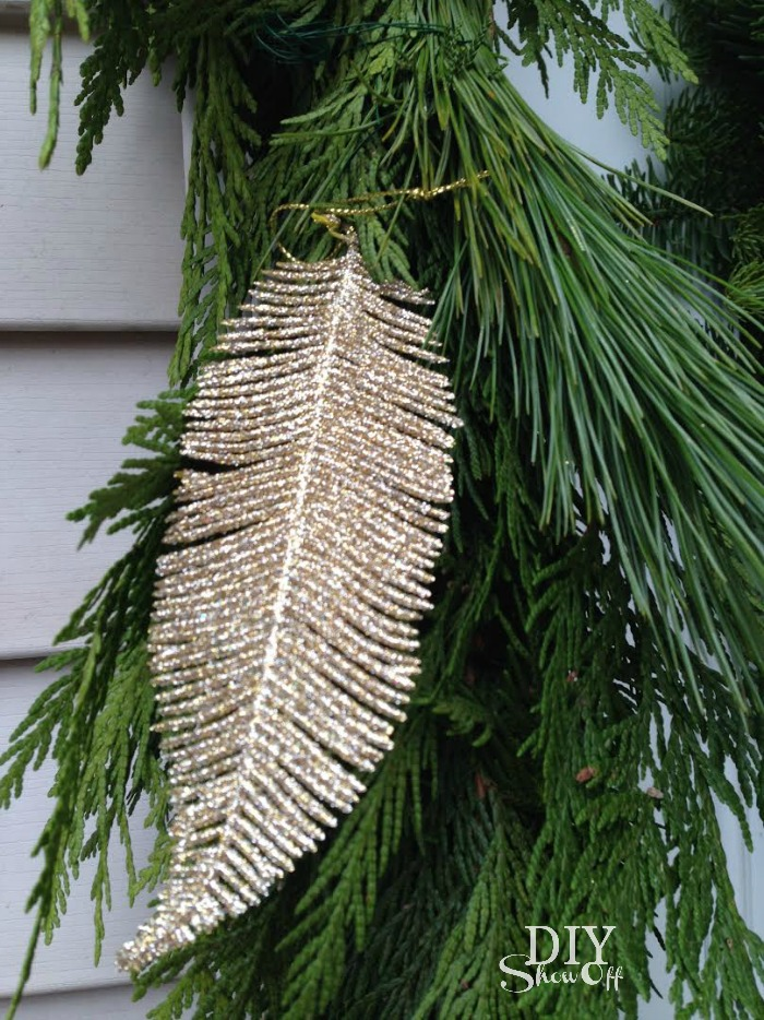 fresh pine garland and gold feather