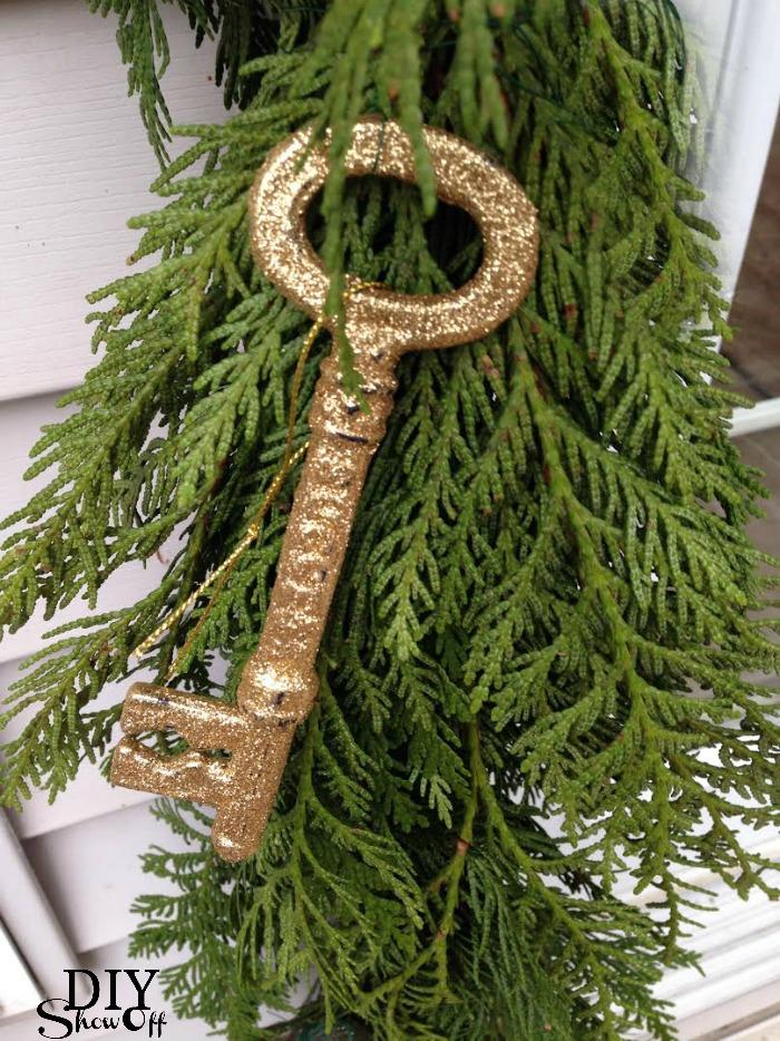 fresh pine garland and gold key