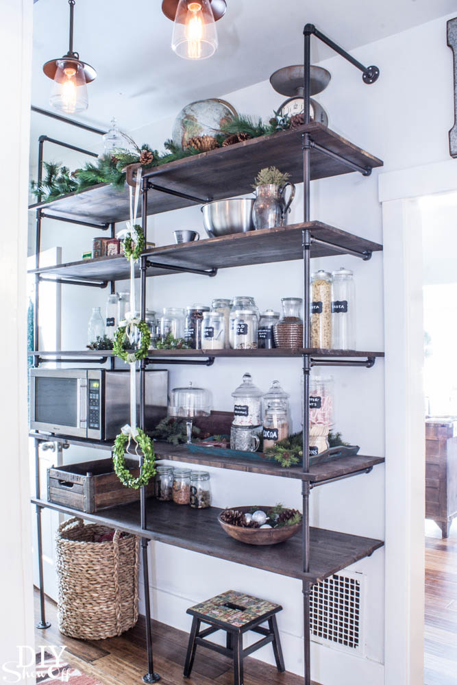 Tips for making a diy industrial pipe shelving unit diy for Kitchen cabinets lowes with outdoor metal star wall art