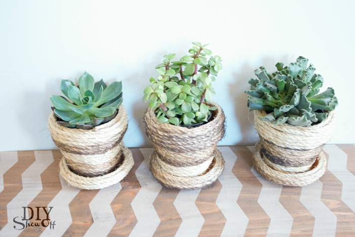DIY sisal rope wrapped terra cotta planters tutorial at diyshowoff.com