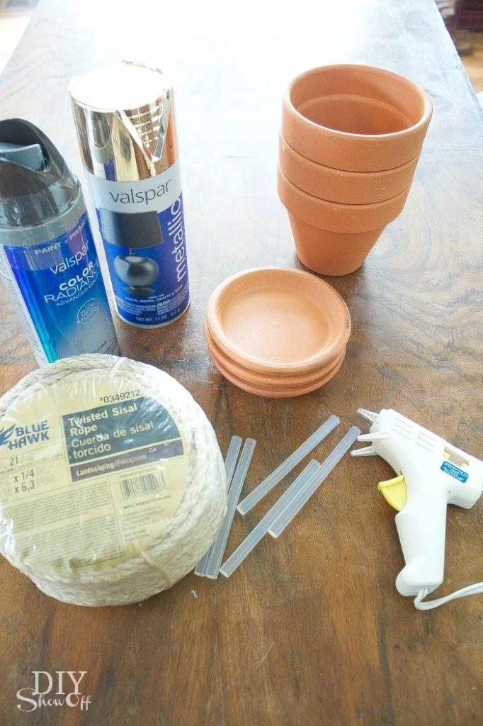 DIY sisal rope wrapped terra cotta planters tutorial at diyshowoff.com