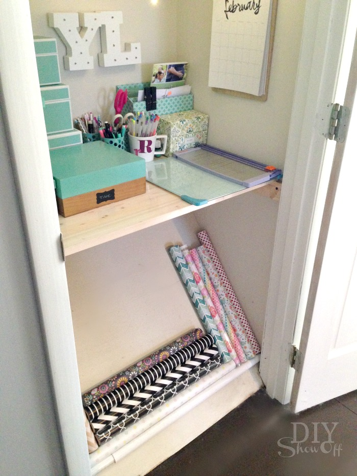 Organization Idea: wrapping paper storage utilizing angled closet floor space!