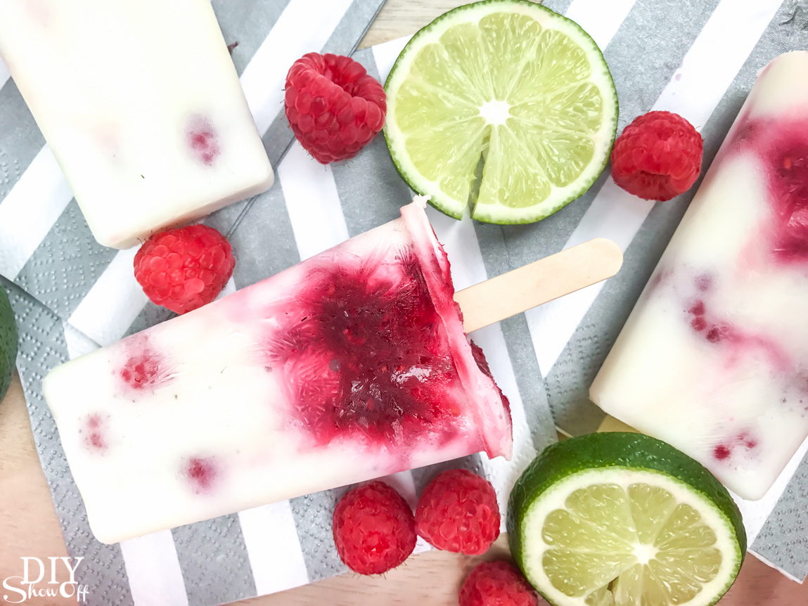 Plan Your Summer Cookout: Raspberry Lime essential oil infused Popsicles recipe @diyshowoff