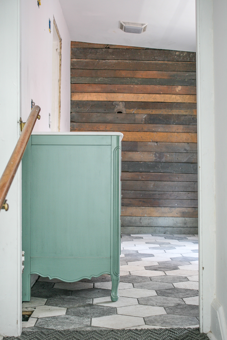 blue vanity hexagon tile floor with shiplap wall