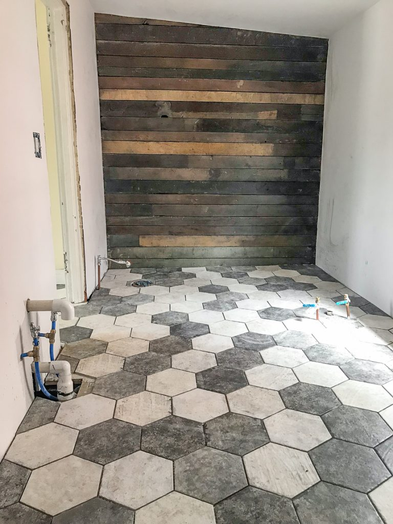 shiplap wall with hexagon tile floor