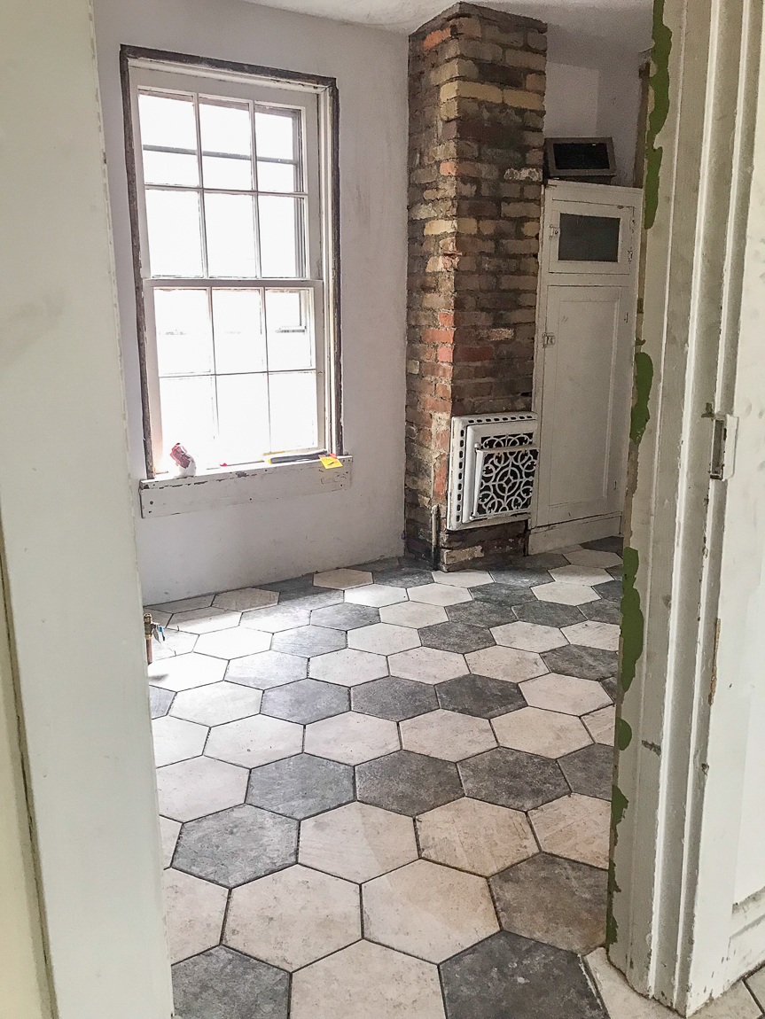exposed brick and hexagon tile floor