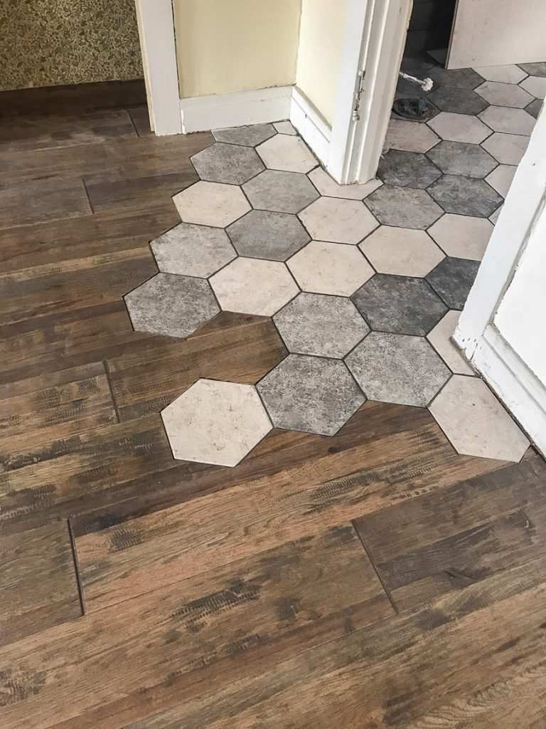 flowing tile to hardwood transition