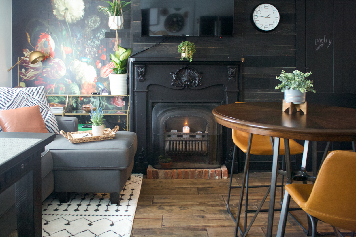 black fireplace black wall reclaimed wood plank wall