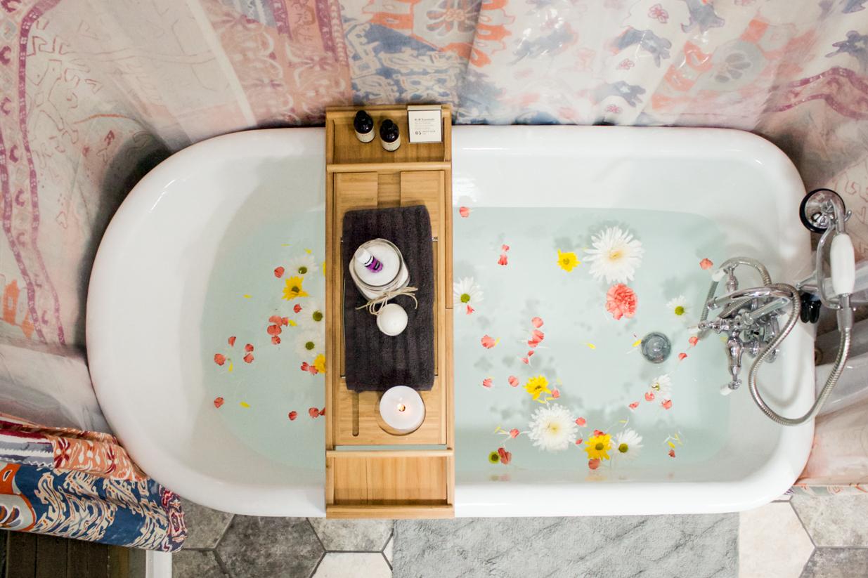 clawfoot tub flower bath essential oils